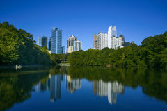 Skycrapper in Atlanta Downtown with reflection. A photo with group of buildings in Atlanta Downtown. The lake in piedmont park gives the beautiful night scene a Stock Image
