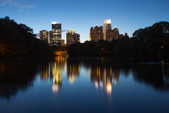 Skycrapper in Atlanta Downtown with reflection. A photo with group of buildings in Atlanta Downtown. The lake in piedmont park gives the beautiful night scene a Stock Images