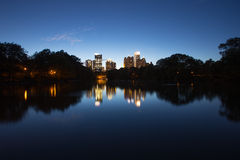 Skycrapper in Atlanta Downtown with reflection. A photo with group of buildings in Atlanta Downtown. The lake in piedmont park gives the beautiful night scene a Royalty Free Stock Photo
