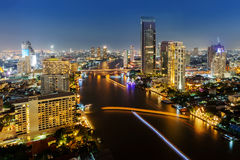 Skycrapper view of Bangkok city with rive at night time. Stock Image