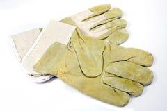 Skyddande handskar Arkivfoto