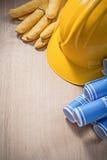 Skyddande handskar för blått för konstruktionsplan läder för hård hatt på wo Royaltyfri Fotografi