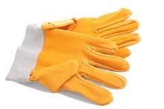 skyddande yellow för handskar Arkivfoto