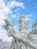 Skyddsängel på den Wat Rong Khun templet i Chiang Rai, Thailand 2 Arkivbild