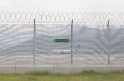SkyddsområdeskyltHong Kong flygplats arkivfoto