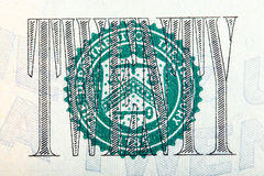Skyddsremsan på Uen S räkning för dollar 20 på makro Royaltyfri Bild