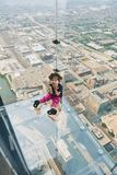 Skydeck Chicago Willis Tower. CHICAGO, IL - SEPTEMBER 2, 2017 : Little girl is standing on the ledge at the Skydeck of the Willis Tower. The Skydeck is on 103rd Royalty Free Stock Images