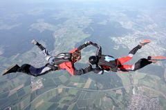 Skydive couple in action. Skydive couple flying in air Stock Images