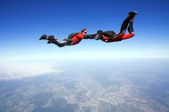 Skydive couple in action. Skydive couple flying in air Royalty Free Stock Photos