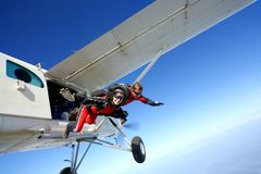 Skydive couple in action. Skydive couple flying in air royalty free stock photo
