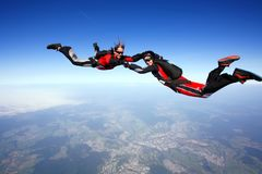 Skydive couple in action. Skydive couple flying in air Royalty Free Stock Photography
