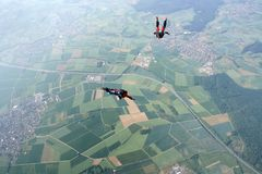 Skydive couple in action. Skydive couple flying in air Stock Photo