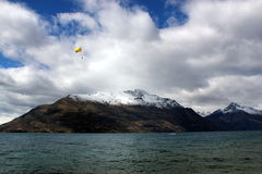 Skydive upon a river nearby snow mountain Royalty Free Stock Image