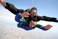 Skydive tandem friends. Skydiving tandem having a fun Stock Images
