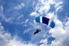 Skydiver. Flying in bright blue sky Stock Photos