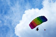 Skydiver. Flying in bright blue sky Stock Photography