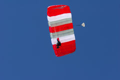Skydiver. Hanging from parachute, gliding on the wind Stock Photos