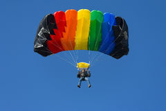Skydiver. Crazy parachutist aiming for landing Stock Images