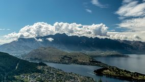 The Remarkables mountains in New Zealand. Skydiver in the air in Queenstown New Zealand with The Remarkables mountain range in the background Stock Photos