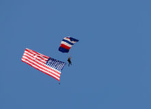 Skydiver with American flag Stock Images