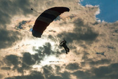 Skydiver on background of clouds. Skydiver on background of the sun and clouds Stock Photo