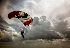 Skydiver in the background of cumulus clouds in the sky Royalty Free Stock Image