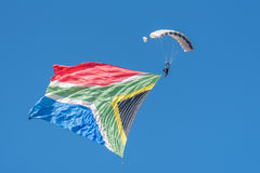 Skydiver with big flag Stock Photo