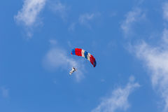 Skydiver among the clouds and blue sky Royalty Free Stock Images