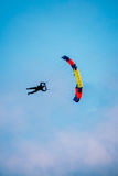 Skydiver On Colorful Parachute In Sunny Sky. Skydiver On Colorful Parachute In Sunny Clear Sky. Active Hobbies Royalty Free Stock Photography
