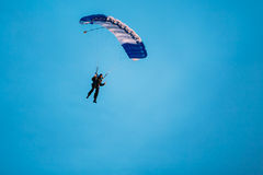 Skydiver On Colorful Parachute In Sunny Sky. Skydiver On Colorful Parachute In Sunny Clear Sky. Active Hobbies Royalty Free Stock Image
