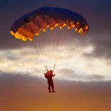Skydiver On Colorful Parachute In Sunny Sky. Skydiver On Colorful Parachute In Sunny Clear Sky. Active Hobbies Stock Image