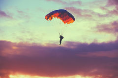 Skydiver On Colorful Parachute In Sunny Sky Royalty Free Stock Photos