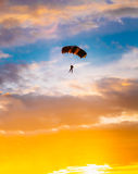 Skydiver On Colorful Parachute In Sunny Sunset Royalty Free Stock Photos