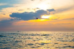 Skydiver on colorful parasailing in sunriae / sunset over the se. Skydiver on colorful parasailing in sunrise / sunset over the sea at pattaya thailand Royalty Free Stock Photography