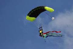 Skydiver coming into land with flag Royalty Free Stock Image