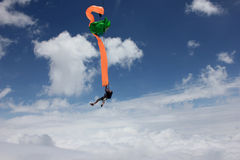Skydiver deploys his parachute Stock Photo
