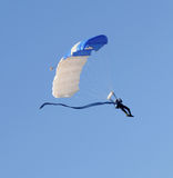 Skydiver descending. Sky diver floating with a rectangular parachute Stock Photos