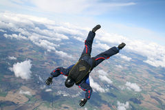 Skydiver dives down. At high speed Royalty Free Stock Photography