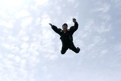 Skydiver falls towards the cameraman. Skydiver with blue jumpsuit falls towards the cameraman Stock Photography