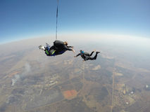 Skydiver films tandem skydive royalty free stock photography