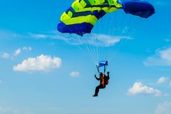 Skydiver flies under the wing of the parachute royalty free stock photos