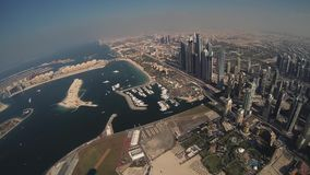 Skydiver fly above Dubai. Parachute. Sunny day. Extreme sport. Cityscape. Beach stock footage