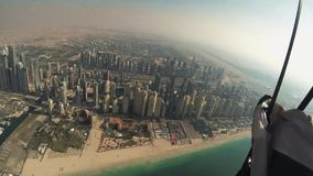 Skydiver fly above Dubai on sunset. Parachute. Extreme sport. Cityscape. Beach stock footage
