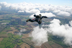 Skydiver in freefall. At high speed Stock Photos