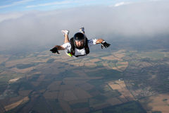 Skydiver in freefall. On a nice sunny day Stock Photos