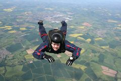Skydiver in freefall. Close up of a Skydiver in freefall Stock Image