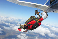 Skydiver jumps from an airplane Stock Image