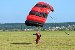 Skydiver landed after the jump Stock Image