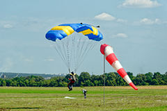 Skydiver landed after the jump Stock Photo