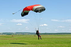 Skydiver landed after the jump Stock Images